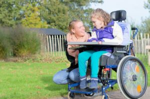 mother talking to her daughter in wheelchair