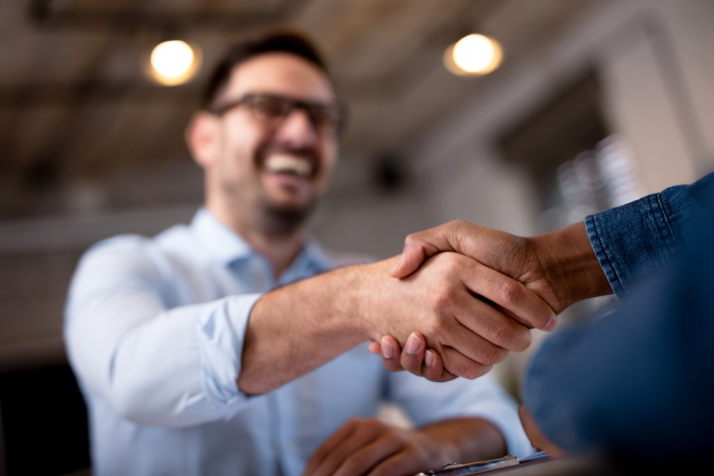 man shaking hands with someone