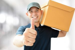 delivery man giving a thumbs up